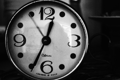 content revolution - close up clock face in black and white